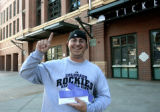 Long time Rockies fan, Matt Thompson (cq), is all smiles after buying play-off tickets at Coors...