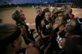 Members of the Brighton softball team revs up for their game against Cherokee Trail at the...