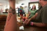 Waitresse Michelle Stuerke (cq) shows a tattoo in honor  of her friend and co-worker  Emily Keyes...