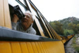 DM0093  John Lahm, 66, of Santa Maria, Calif. leans out the window to record the views in the Las...