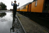 DM0725  Train conductor Ben Barker, 59, signals to the engineer to stretch the train just before...