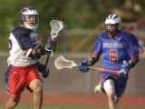Denver, Colo., photo taken May 18, 2004- Kent's Max Kay (LEFT #22) takes the ball down field while...