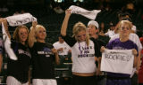 Colorado Rockies fans cheer during during batting practice at Chase Field in Phoenix on Thursday,...
