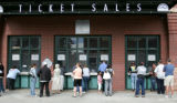 Fans wait in line at noon time to get tickets to tonights game at Coor's Field  Friday September...