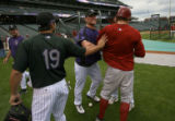 [ES0014] Colorado Rockies players Ryan Spilborghs, left, Matt Holliday, and Garrett Atkins shove...