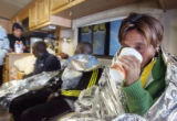 Elite full marathon runner Martha Tenorio (cq) takes a sip of hot coffee at the end of the 2007...