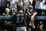 [JOE0312] Colorado Rockies third baseman Garrett Atkins in congratulated after scoring on a triple...