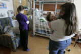 Janay Skinner (cq) holds her 10-month-old son Milo Skinner, who suffers from a small and...