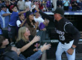 [JOE0910] Colorado Rockies manger high-fives fans after the Rockies defeated the Arizona...