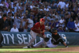KNP00753 Troy Tulowitzki of the Colorado Rockies slides into 3rd from single from Matt Holiday,...