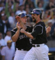 KNP00841 Todd Helton of the Colorado Rockies scores from Brad Hawpe Double in the 8th inning. The...