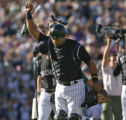 [ES0494] Colorado Rockies catcher Yorvit Torrealba raises his fist in celebration after the...