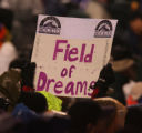 "Fans hold a ""Field of Dreams"" sign in the late innings of the Colorado Rockies game..."
