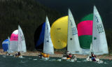 (DILLON Colo., June 27,2004)  Some of the 30 sailboat form the Dillon Yacht Club take part in a...