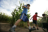 Just getting to run around is fun for Patrick Stadelmaier, 7, James Stadelmaier, 8 and Max...