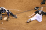 Matt Holliday scores the winning run in the Rockies 9-8 victory in 13 innings. The Colorado...