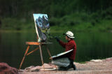 (ASPEN  Colo., July 3,2004)   Shaun Horne, from Crested Butte, works on his painting of the Maroon...
