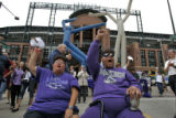 DM1302 Bon and Cynthia Candelaria cheer as fans have a rally for the Colorado Rockies at 21st and...