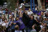 DM1347 Fans leap into the air for free Rockies t-shirts as they are thrown into the crowd during a...