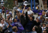 DM1348  Fans leap into the air for free Rockies t-shirts as they are thrown into the crowd during...