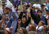 DM1393 Fans leap into the air for free Rockies t-shirts as they are thrown into the crowd during a...