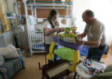 Janay Skinner (cq) and father John Skinner (cq), from Alamosa, unpack the last few items from her...