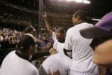 DM4808  Rockies players encourage Ramon Ortiz to take the field to celebrate with the remaining...
