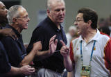 American basketball coach Larry Brown, left, exchanges words with Spain's coach Mario Pesquera,...
