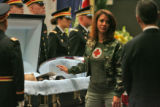 Tammie Stone (cq), touches the casket of her grandfather Brigadier General Felix Sparks (cq)...