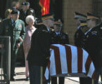 Mary Sparks (cq), walks behind honor guard during funeral for her husband Brigadier General Felix...