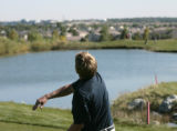 Beau Schoolcraft, Kent Denver, throws his golf ball into the lake, after winning the Boys 4A State...