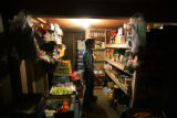 Teresa Taylor looks over the supplies in the root cellar at Barr Camp, in Manitou Springs, Colo....