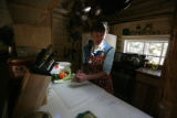 Teresa Taylor cuts up some garlic at Barr Camp, in Manitou Springs, Colo. Sunday , September 30,...