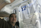 Sportsfan manager Pete Martinez (cq) cleans a Rockies hat display at the Sportsfan sports store on...