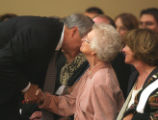 Gov. Bill Ritter (cq) kisses Mary Sparks (cq) ,wife of Felix Sparks (cq) at funeral for Brigadier...