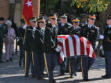 Mary Sparks (cq) (left) walks behind the honor guard during her husband's funeral, Brigadier...