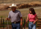 (Heeney Colo.,  June 23, 2004)  Grady and Gayle Culbreath head out to help cut cattle June 23,...
