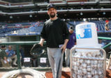 [ES1815] Rockies first basemen Todd Helton takes the field for batting practice before taking on...