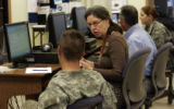 Army Career and Alumni Program counselor Laura Plaxton (cq), talks with Sgt. Thomas Templin (cq)...