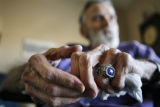 "87-year-old Benny hensen (cq) wears one of two ""Over 80"" Softball World Series rings,..."