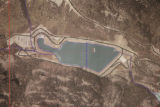 An aerial photograph of the XCel Energy Hydroelectric power plant is posted on the wall of the...