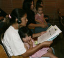 Marisela Rodriguez  (cq) holds her daughter Juliet, as she listen to a translation on a headset ...