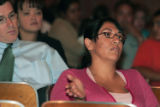 Janette Encerrado (cq) asks a question Wednesday night at a meeting for parents at Whiteman Elem....
