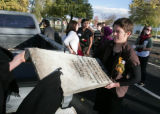Krystan Bruce (cq) left, out of frame, and Sally Barto (cq) load  a headstone into a truck bed off...