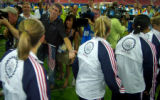 (ATHENS, GREECE- AUGUST 26,2004) United States' gold medal swimmer, Michael Phelps slaps hands...