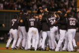 The Rockies celebrate winning the National League Championship Series 6-4 against the Arizona...