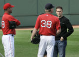 MACK106 - Boston Red Sox general manager Theo Epstein, right, talks with pitchers Curt Schilling...