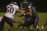 Columbines #88 Ben Tedford blocks  Arvada's # 50 Zach Negri in the 2nd quarter at the Jefferson...