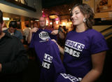 Waitress, Michelle Miller, (cq) hands out free t-shirts that comboed the tavern and rockies themes...