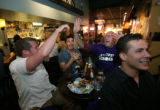 Nathan Duncomb (cq) Sam Duren (q) Gregg Calhoun (cq) and Jesse Horan (cq) (l-r) cheer after the...